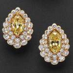 Fancy-colored Diamond and Diamond Earrings (Lot 562, Estimate $75,000-  $85,000)
