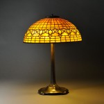 Tiffany Studios Pomegranate Table Lamp, Art glass and patinated bronze, New York, early 20th century (Lot 10, Estimate $8,000-$12,000)