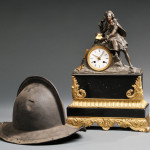 French Black Slate and Gilt Mantel Clock, mid to late 19th century (Lot 1338, Estimate $200-$300) and Continental Morion Helmet, c. 17th century (Lot 1074, Estimate $400-$600)