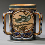 Doulton Lambeth Florence Barlow Decorated Three-handled Tyg, England, late 19th century (Lot 555, Estimate $700-$900)