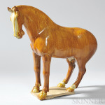 Sancai-glazed Pottery Figure of a Horse, China, Tang dynasty (Lot 114, Estimate $10,000-$15,000)