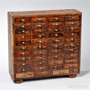 Miniature Case of Forty-four drawers, probably America, 19th century (Lot 1005, Estimate $600-$800)