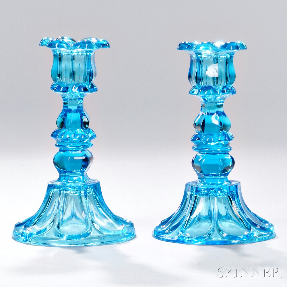Pair of Peacock Blue Pressed Glass Petal and Loop Pattern Candlesticks, Boston & Sandwich Glass Company, Sandwich, Massachusetts, c. 1840-60 (Lot 11, Estimate $300-$500)
