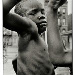 Leonard Freed (American, 1929-2006)  Muscle Boy, Harlem, 1963, printed later. (Lot 102, Estimate $1,200-$1,800)