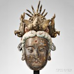 Polychrome and Gilt Stucco Head of Guanyin, China, Ming dynasty (1368-1644) (Lot 428, Estimate $10,000-$12,000)