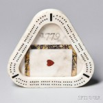 """Triangular Carved Inlaid Marble """"1779"""" Cribbage Board, probably England, c. 1779 (Lot 1189, Estimate $300-$500)"""