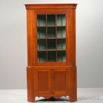 Federal Carved and Glazed Cherry Two-part Corner Cupboard, possibly Pennsylvania, early 19th century (Lot 1523, Estimate $800-1,200)