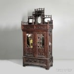 Tramp Art Cabinet, Wood, mirrored glass, New York, 1921 (Lot 1003,   Estimate: $6,000-8,000)