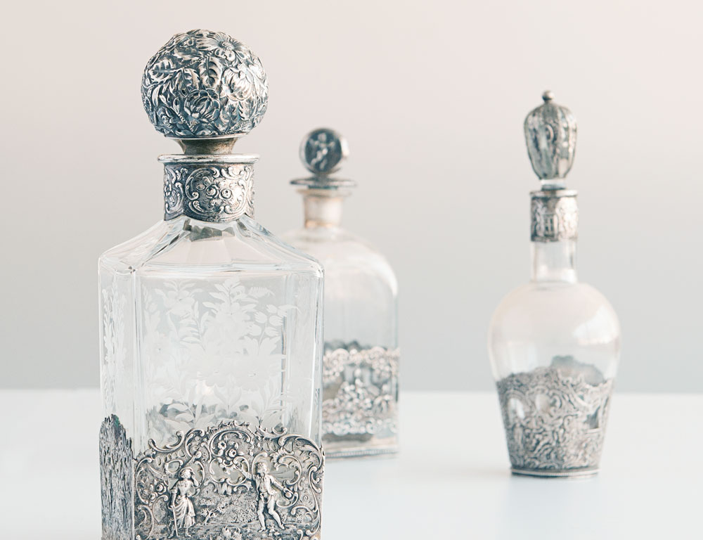 Three Silver-mounted Glass Decanters (Lot 1389, Estimate: $200-400)