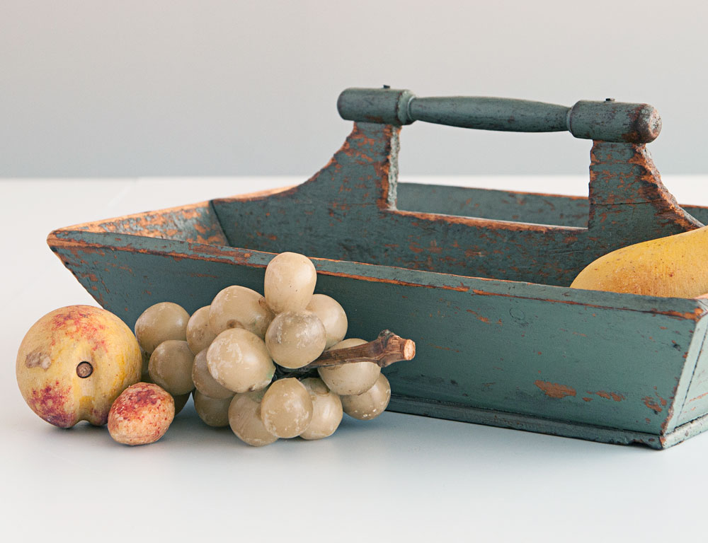 Carved and Turned Blue-painted Knife Box and Five Pieces of Stone Fruit (Lot 82, $300-500)